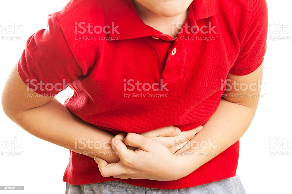 Child with stomach pain stock photo