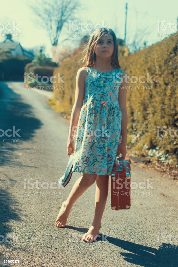 Child with suitcase stock photo