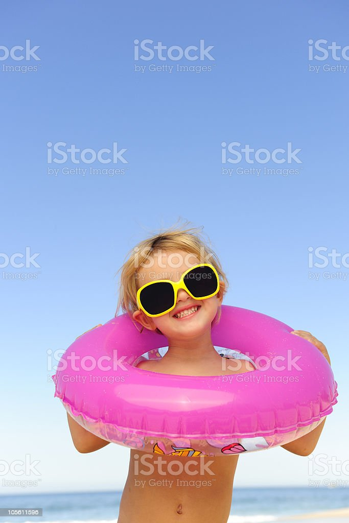 child with sunglasses and inflatable ring at the beach royalty-free stock photo