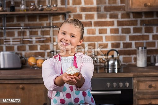 istock child with sweet cupcake 862739272