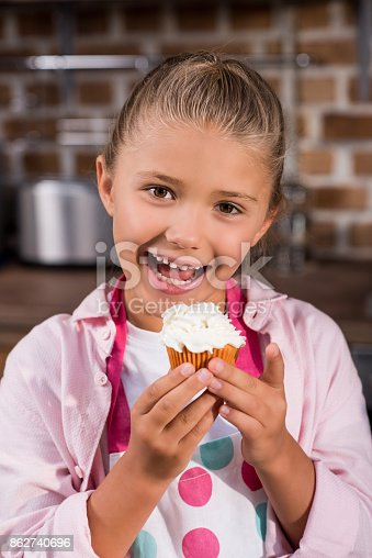 istock child with sweet cupcake 862740696