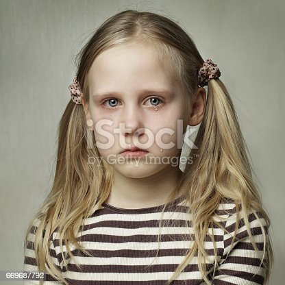 istock Child with tears - young girl crying, sadness 669687792