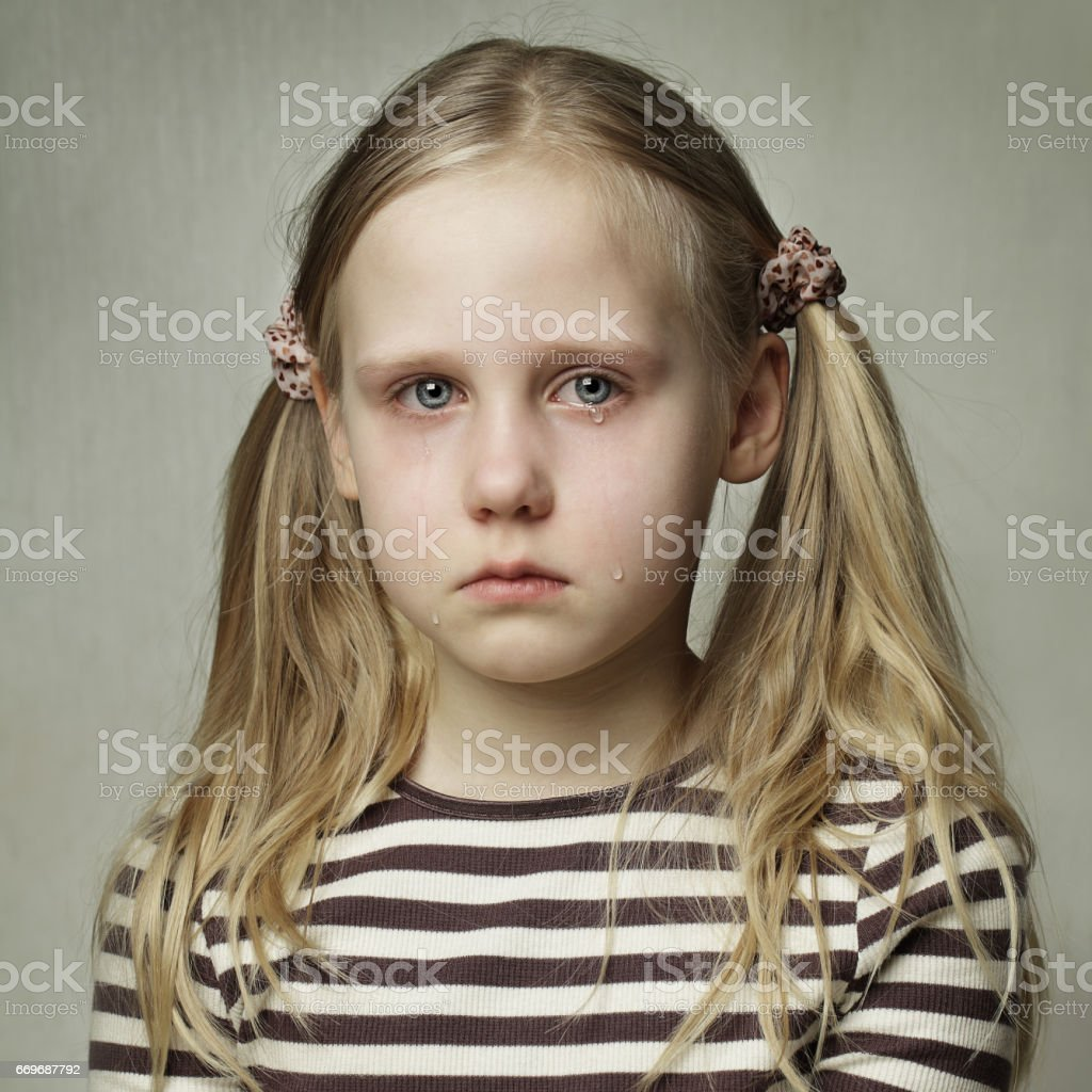 Child with tears - young girl crying, sadness stock photo