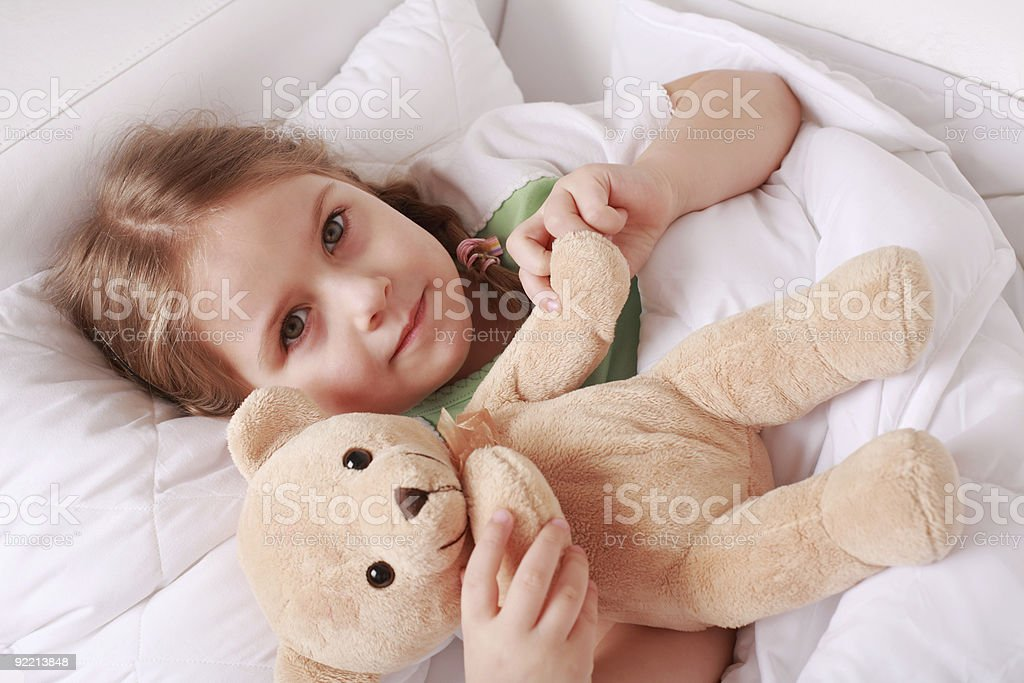 Child with teddy stock photo