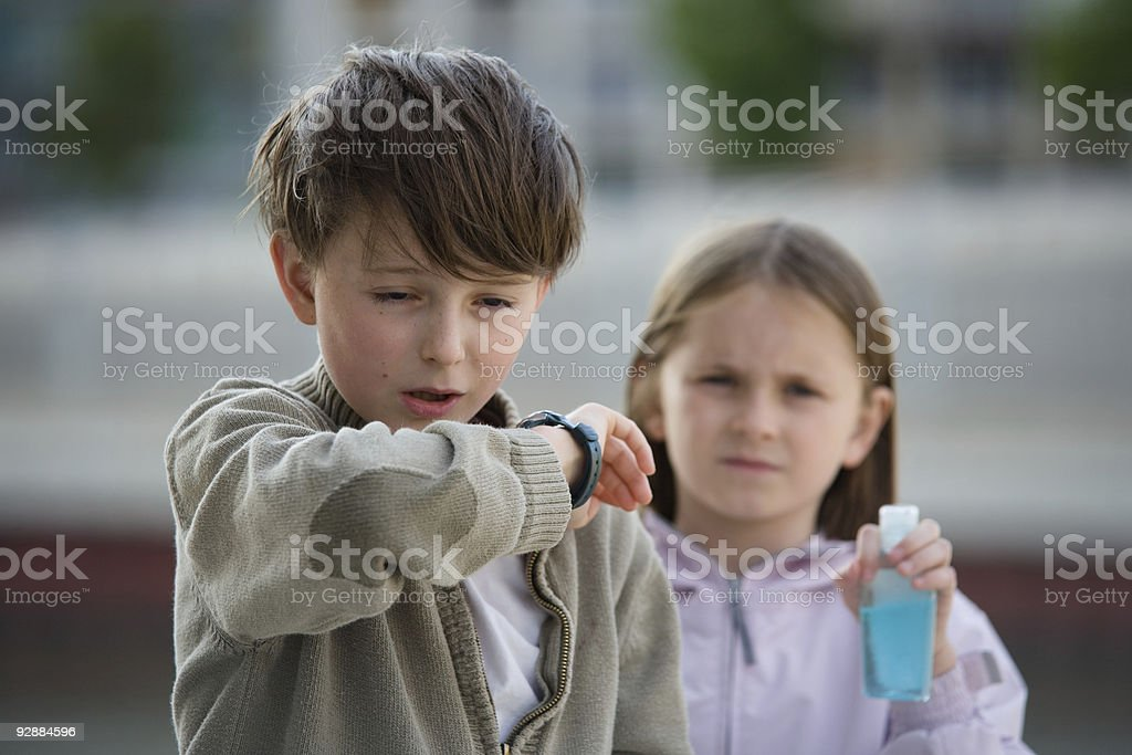 A child with the flu sneezing into his elbow royalty-free stock photo