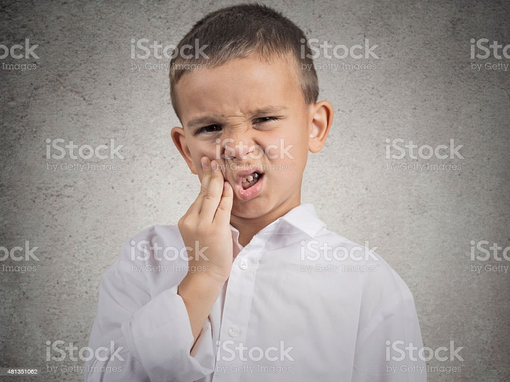 Child with toothache stock photo