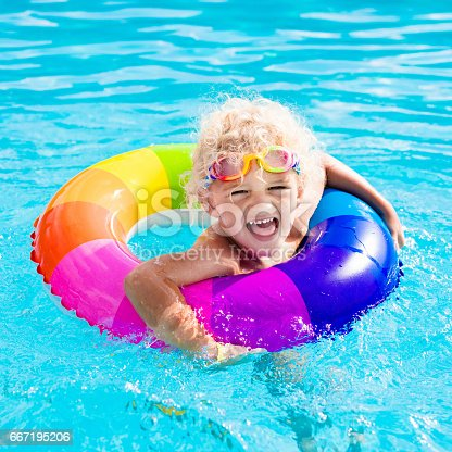 istock Child with toy ring in swimming pool 667195206