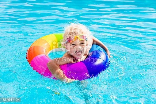 467327992istockphoto Child with toy ring in swimming pool 674941124