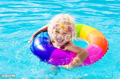 467327992istockphoto Child with toy ring in swimming pool 675013798