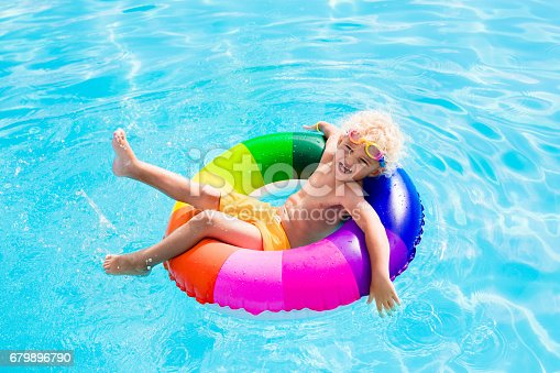 istock Child with toy ring in swimming pool 679896790