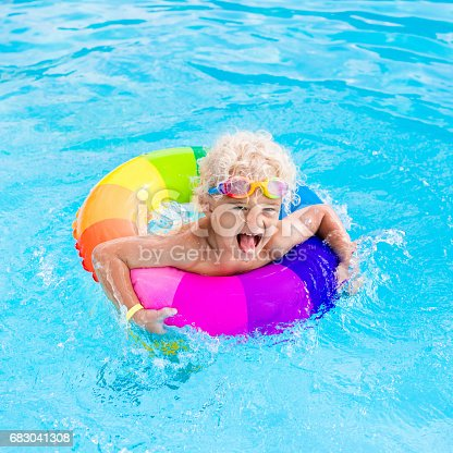istock Child with toy ring in swimming pool 683041308
