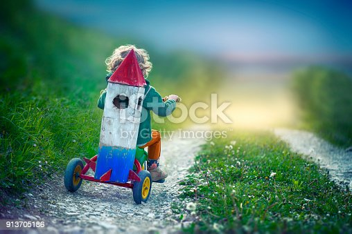 istock Child With Toy Space Rocket and Tricycle 913705186
