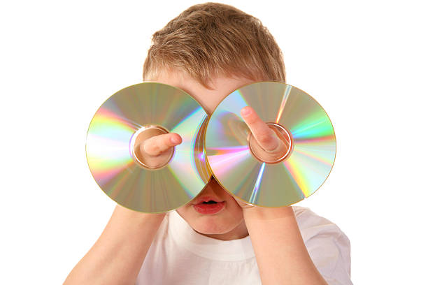 child with two cd stock photo