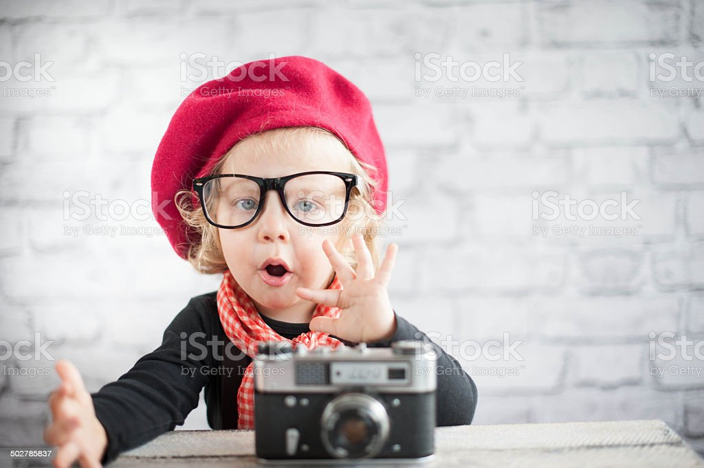 Child with vintage camera stock photo