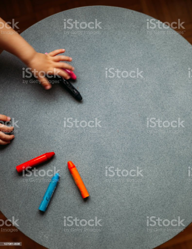 child with wax pencils. Concept background for art and stationery shop