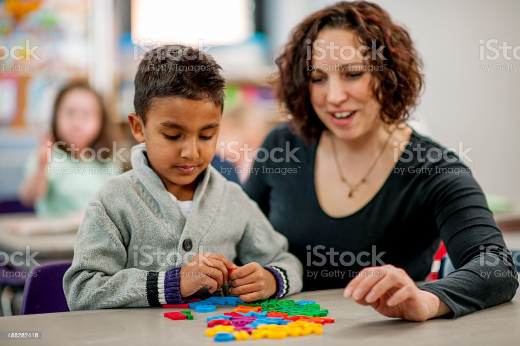 Child Working on His Spelling stock photo
