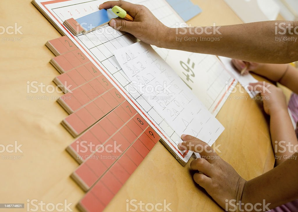 Child working on math problem royalty-free stock photo