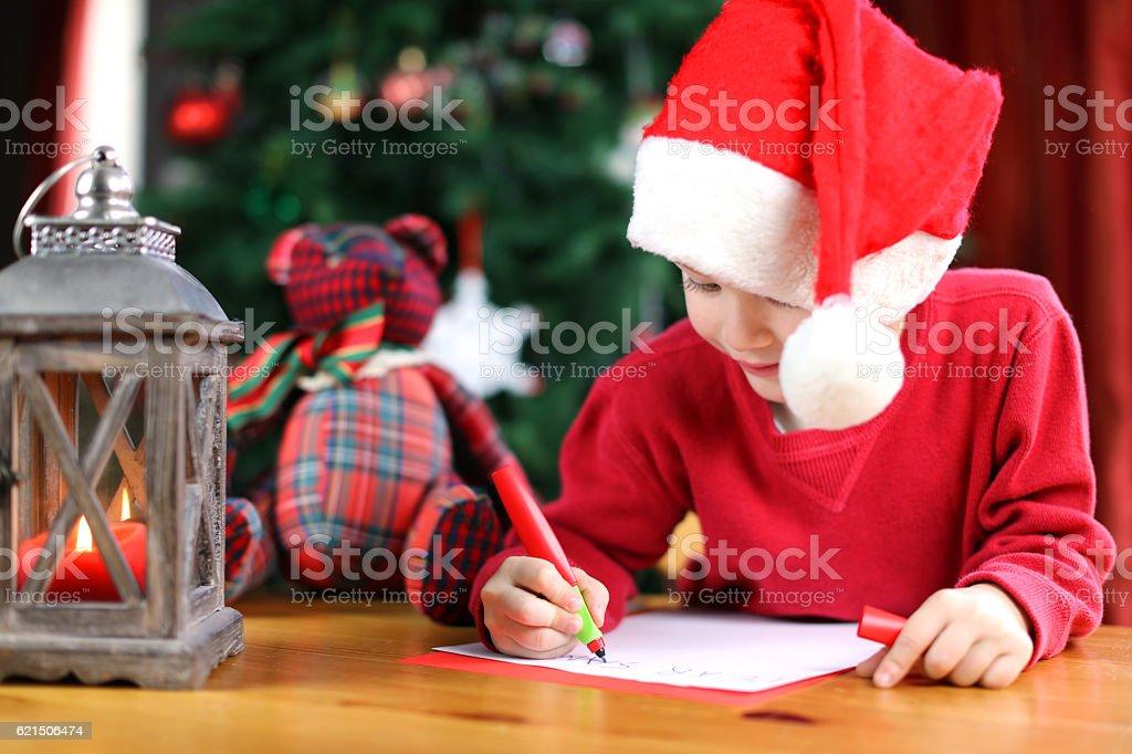Child Writing a Christmas Letter to Santa Claus Lizenzfreies stock-foto