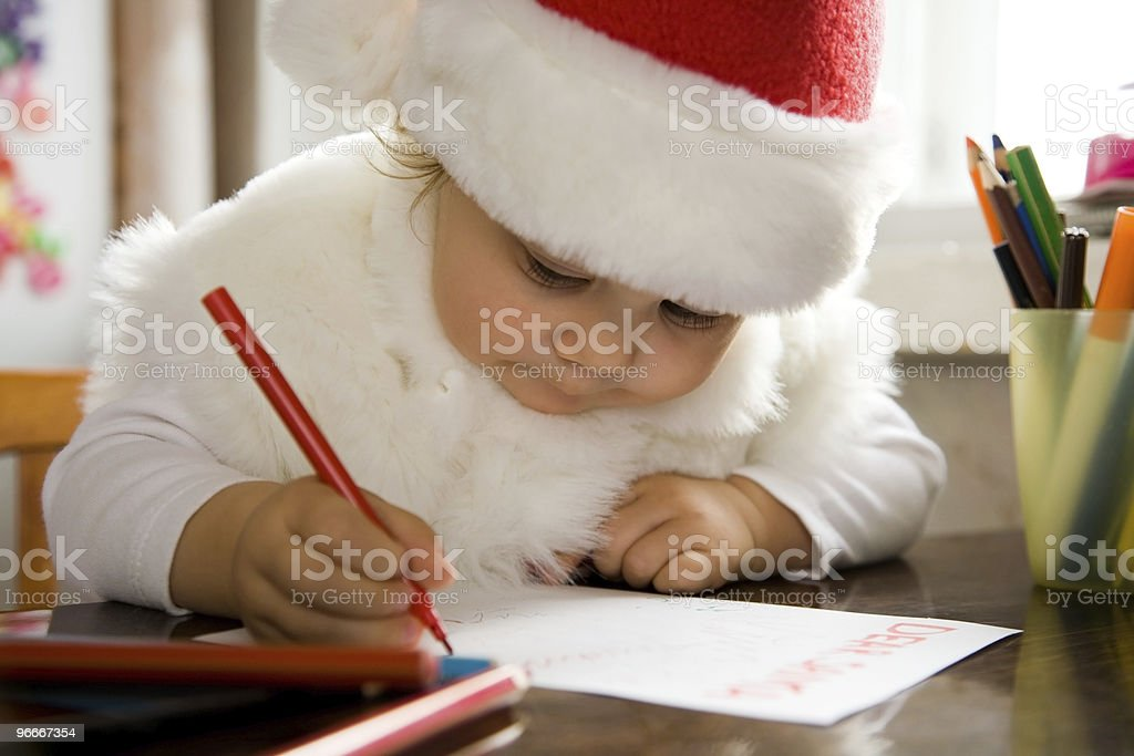 A child writing a letter to Santa stock photo