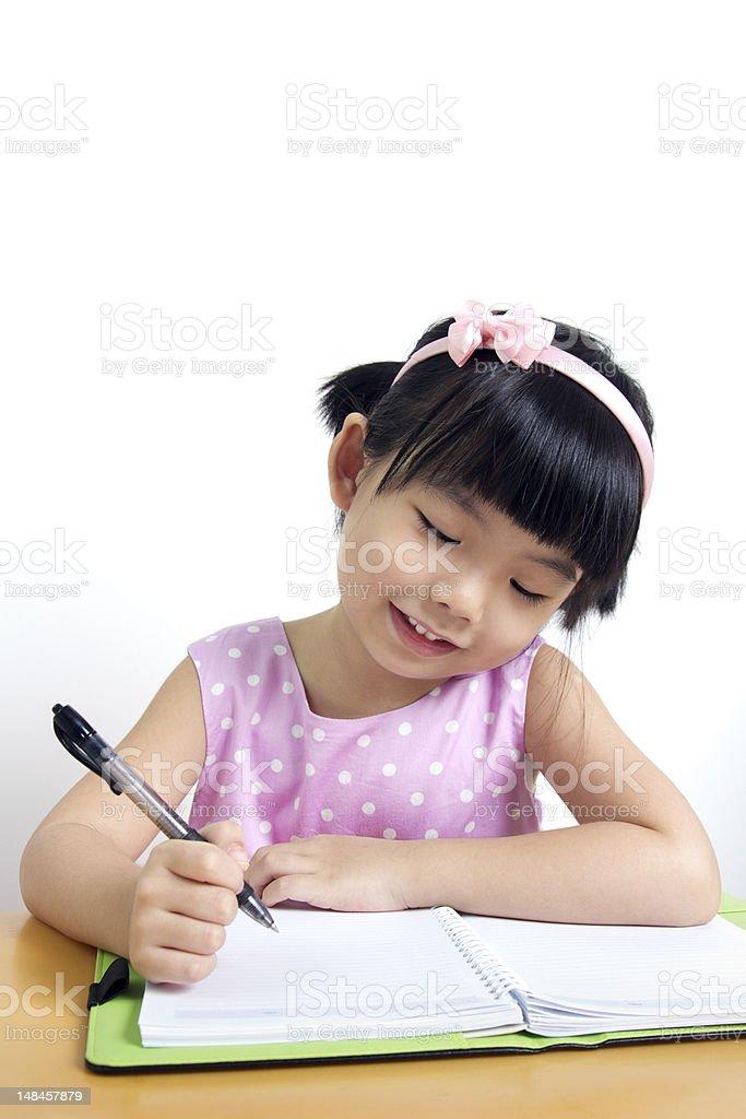 Child writing royalty-free stock photo