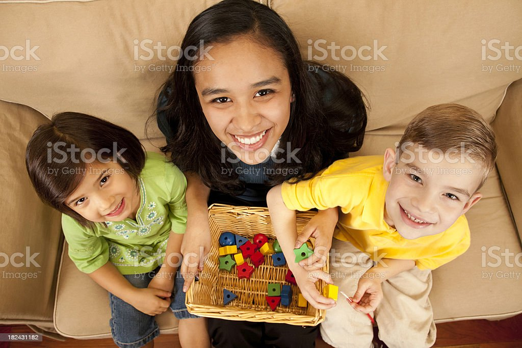 Childcare Baby Sitter with Two Children royalty-free stock photo
