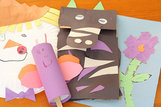 Childhood Crafts A paper plate scarecrow, a toilet paper roll butterfly, a paper bag zebra puppet, and a tear-and-paste flower.  Fun crafts for any child! puppet stock pictures, royalty-free photos & images