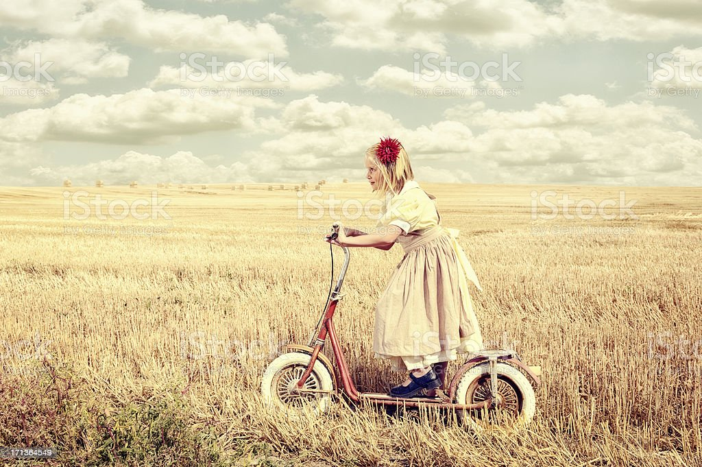 Childhood Memories - Girl On Scooter royalty-free stock photo