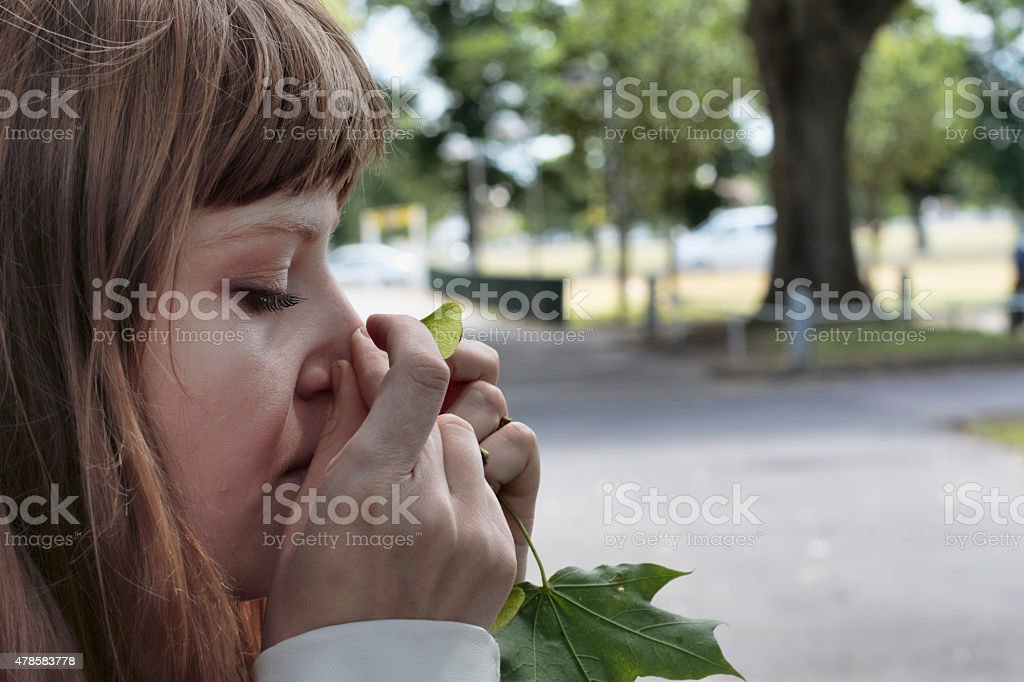 Latvian outdoor rhino girl fixing maple seed horn stock photo