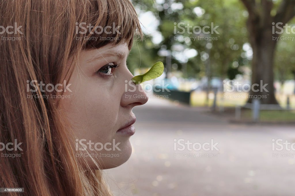 Latvian outdoor rhino girl displaying one maple seed horn stock photo