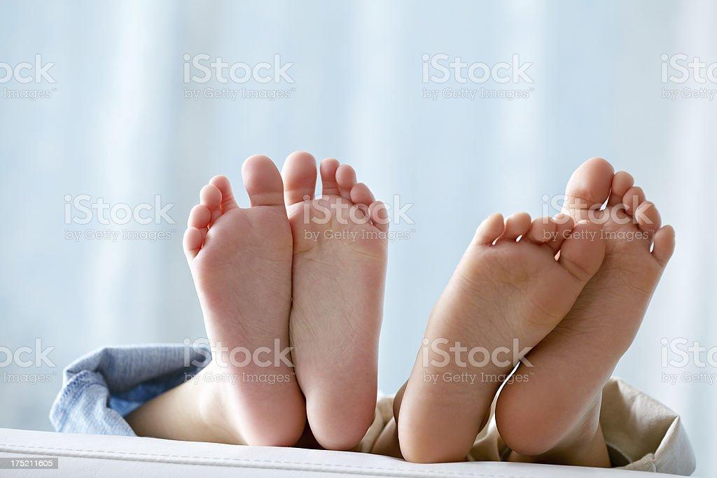Childish feet stock photo
