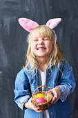 Excited girl with Easter basket enjoying religious celebration