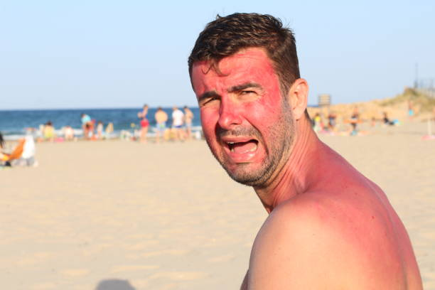Childish looking adult crying at the beach stock photo