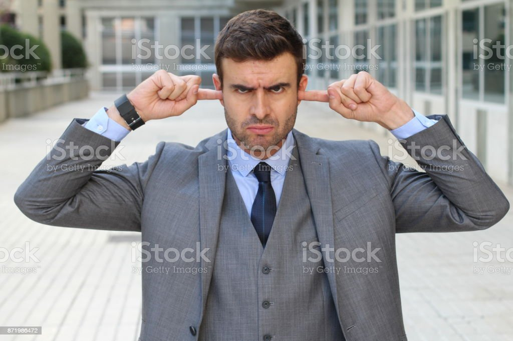 Childish mad worker showing contradiction stock photo