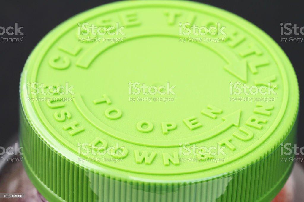 Childproof medicine bottle lid. stock photo