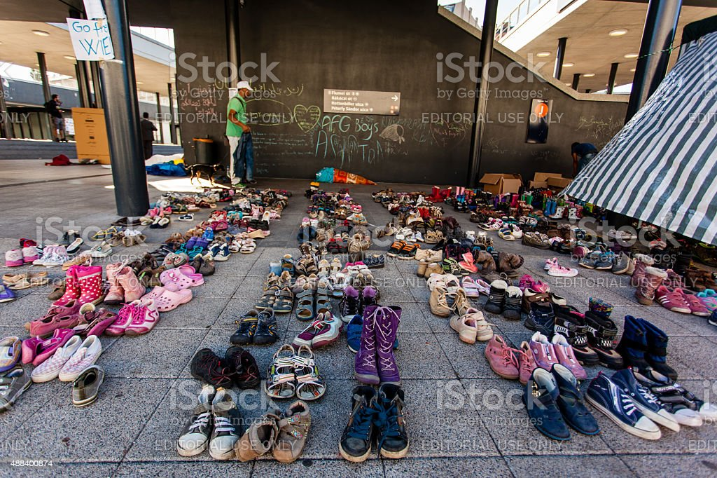 Childre shoes from war refugees at the Keleti Railway Station stock photo