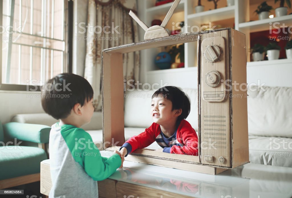 Children and a handmade toy TV stock photo
