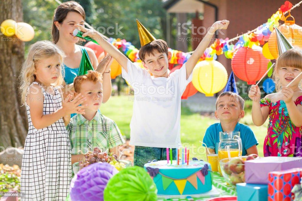 Children and birthday boy stock photo
