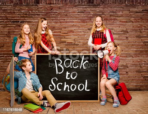 991060890 istock photo Children and Blackboard with Drawing, Back to School, Young Students Black Chalkboard 1167618548