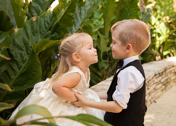 children and love - little girls little boys kissing love stock photos and pictures