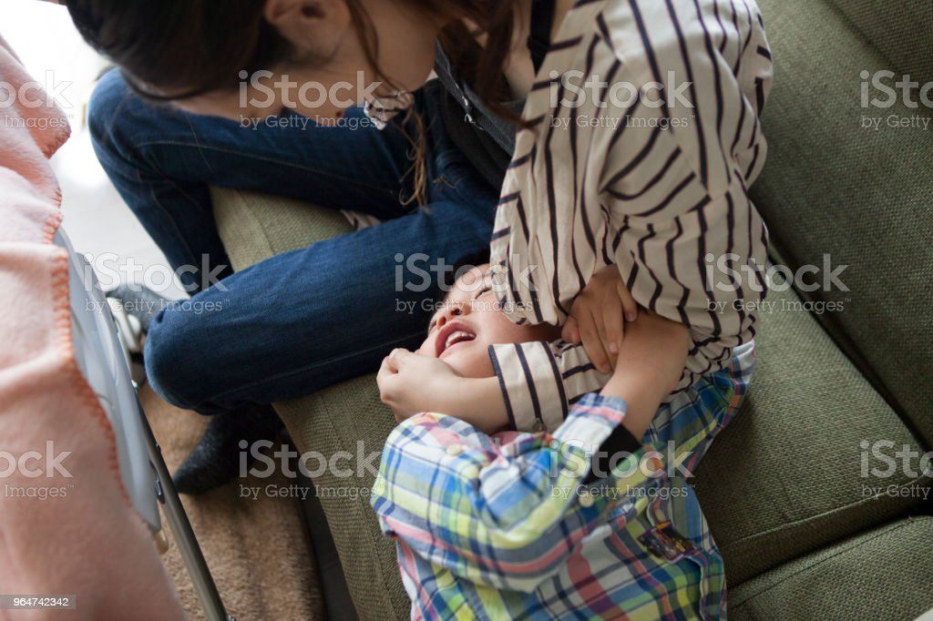 Children and mothers playing on the sofa. royalty-free stock photo