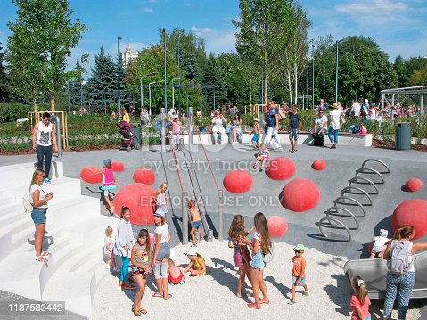656743520 istock photo Children and parents on playground, active rest in the park 1137583442