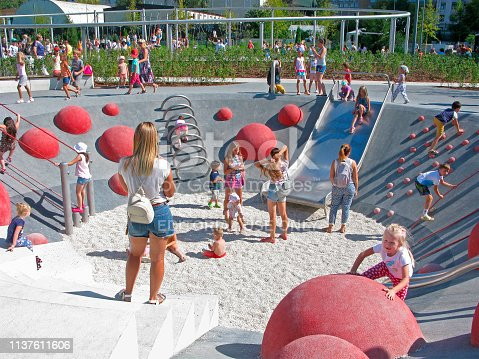 656743520 istock photo Children and parents on playground, active rest in the park 1137611606