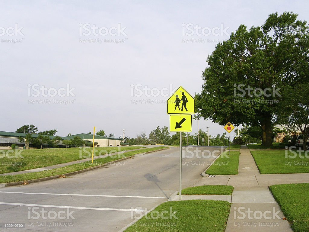 Children and Pedestrian Crossing Sign stock photo