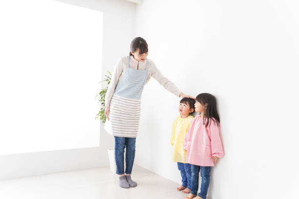 Kids Comparing Height Stock Photos, Pictures & Royalty-Free Images - iStock