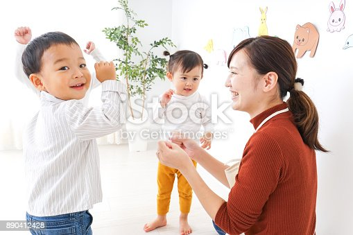istock Children and teacher at Kindergarten 890412428