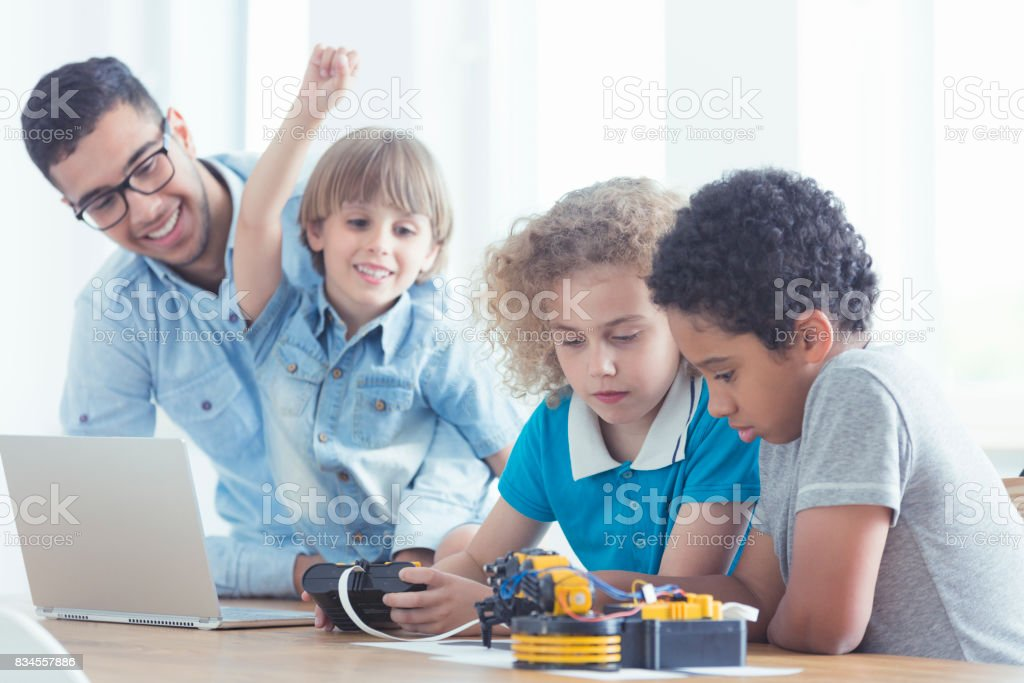 Children and teacher during classes stock photo