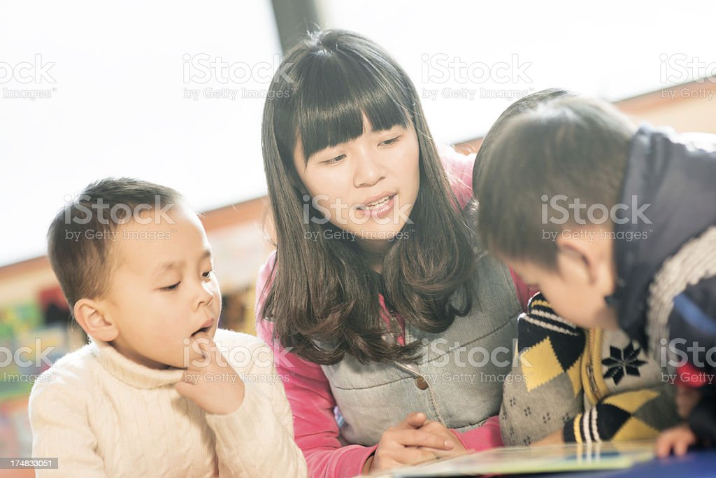 children and teacher in classroom royalty-free stock photo