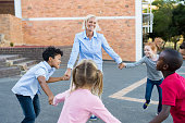 istock Children and teacher playing together 950607794