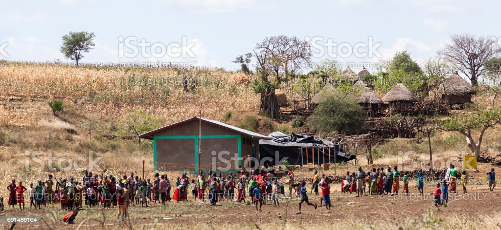 Children and teachers of rural school at a school playground stock photo