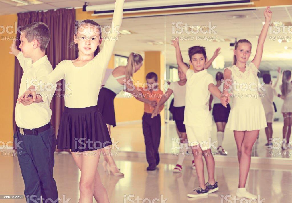 Children are dancing twist in pairs stock photo